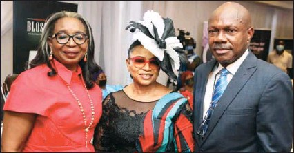 ??  ?? •From left: Immediate First Bank of Nigeria Past Chairman Mrs. Ibukun Awosika; Author Apostle Folorusho Alakija and book reviewer Sonny Iroche during the presentation of Alakija's new book, titled: Blossoming with the hands that gives the Rose in Lagos...yesterday
