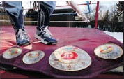?? Gavin Young, Calgary Herald ?? One of Bruce Hart's championship belts rests in the original Stampede Wrestling ring in Bruce's Calgary backyard.