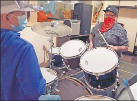 ?? Sean Vogt (left) practices with Bohon. ?? Intermediate drummer student