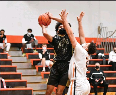 ?? Photo by Jerry Silberman / risportsphoto.com ?? Davies Tech forward Antonio Cabral (11) attempts a shot in the first half of Monday night's overtime victory over West Warwick to keep the Patriots undefeated in Division III.