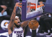 ?? Darron Cummings / Associated Press ?? Sacramento forward Marvin Bagley III piled up 31 points and 12 rebounds in leading the Kings past Indiana.