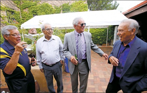 ?? PHOTOS BY LUIS SÁNCHEZ SATURNO/THE NEW MEXICAN ?? From left, Santa Fe High graduates Ralph Ortiz, Class of 1962; Ramon Encinias, Class of 1961; Richard Robinson, Class of 1961; and Phil Sanchez, Class of 1961, talk about playing football Friday at a reunion at the Elks Lodge.