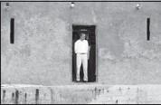 "?? REBECCA BLACKWELL/ASSOCIATED PRESS ?? President Barack Obama stands in the ""Door of No Return"" at the slave house on Goree Island, in Dakar, Senegal on Thursday."
