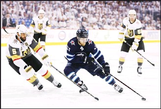 ??  ?? Nikolaj Ehlers #27 of the Winnipeg Jets is defended by Deryk Engelland #5 of the Vegas Golden Knights during the second period in Game One of the Western Conference Finals during the 2018 NHL Stanley Cup Playoffs at Bell MTS Place on May 12, in...