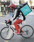 ?? Picture: Jack Taylor/Getty Images ?? A Deliveroo rider cycles through London.