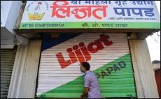 ??  ?? a staff member of Shri Mahila Griha Udyog opens one of the organisation's facilities in Mumbai.