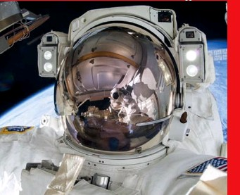 ??  ?? Right: Virts floating above Earth on one of his three extravehicular activities