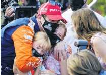 ?? PHOTO: USA TODAY ?? Family affair . . . New Zealander Scott Dixon is congratulated by wife Emma (right) and daughters Poppy and Tilly after winning his sixth IndyCar championship thanks to his third in the Grand Prix of St Petersburg in Florida yesterday.