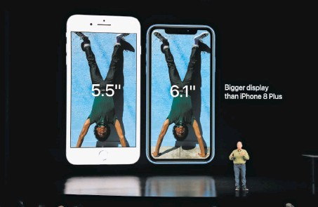 ?? Jim Wilson / New York Times ?? Philip Schiller, Apple's senior vice president for marketing, shows off the new iPhone XS and iPhoneXS Max at the debut event.