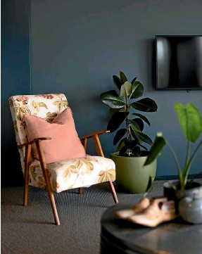 ??  ?? Designer Kylie Greer's living area in her holiday home in Te A¯ nau uses darker colours for warmth.