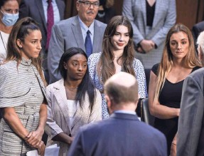 ?? ANNA MONEYMAKER/GETTY IMAGES ?? From left, Aly Raisman, Simone Biles, McKayla Maroney and Maggie Nichols appear before members of the Senate Judiciary Committee to discuss the FBI's handling of the Larry Nassar investigation.