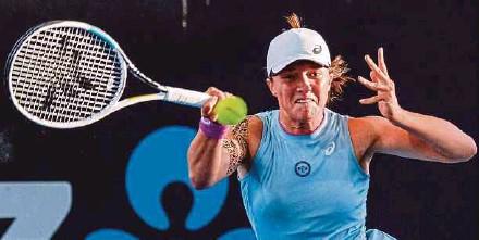 ?? AFP PIC ?? Iga Swiatek returns a shot to Belinda Bencic in the final of the Adelaide International at Memorial Drive yesterday.