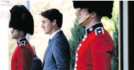 ?? JUSTIN TANG / THE CANADIAN PRESS ?? Prime Minister Justin Trudeau arrives for a press conference following a swearing-in ceremony on Wednesday.