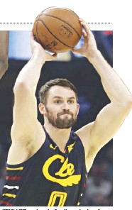 ?? AP ?? KEVIN LOVE receives the first Humanitarian of the Year Award on Thursday night at the Greater Cleveland Sports Awards.