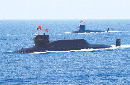 ?? REUTERS / STRINGER ?? Above is China's Type 094A Jin- class ballistic missile submarine. China's next generation of nuclear submarines —