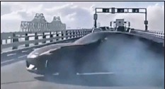 ?? PHOTO CAPTURED VIA YOUTUBE ?? A driver does donuts across three lanes on the Chesapeake Bay Bridge amid heavy traffic in September 2020.
