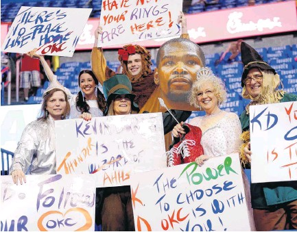 ?? [PHOTO BY SARAH PHIPPS, THE OKLAHOMAN; IMAGES BELOW PROVIDED] ?? From left to right, Brenda Wright, Madison Benham, Stephanie Ballard, Jonathan Benham, Marcy Twyman and Dwayne Tate cheer before Game 6 of the Western Conference semifinals between the Oklahoma City Thunder and the San Antonio Spurs earlier this month in the NBA Playoffs at Chesapeake Energy Arena. They have been dressing up since 2012.