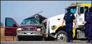 ?? GREGORY BULL / AP ?? Thirteen people were killed Tuesday when an SUV carrying 25 people and a semitruck collided on a Southern California highway, authorities said.