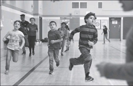 ??  ?? Above: participants do laps in the gym at Dr. Edgar Davey school.