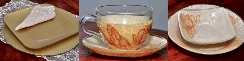 Coffeebeigebiscuit coloured  sinamay saucer with long coque feathers and sinamay twists.