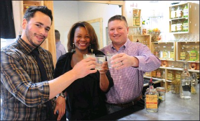 ?? Ernest A. Brown photos ?? White Dog Distillers, located in the Lorraine Mills complex at 560 Mineral Spring Ave. in Pawtucket, held a grand opening at their facility Tuesday. Owners from left, Eric Sylvestre, Alecia Catucci, and her husband, Carlo Catucci, toast to their new...