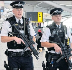 ??  ?? Armed police patrol Heathrow in a bid to deter terrorist attacks