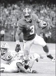 ?? By Paul Morse for USA TODAY ?? Top back: Trent Richardson, eluding defenders in January's BCS title game, could be picked at No. 5 by the Buccaneers, unless the Browns snap him up with the fourth pick.