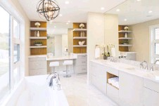 ??  ?? Open shelving, as featured in this bathroom by AYA Kitchens, help create a spa esthetic. White is still a popular colour with natural wood highlights.