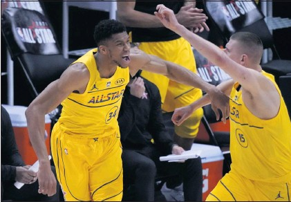 ?? BRYNN ANDERSON — THE ASSOCIATED PRESS ?? Bucks forward Giannis Antetokoun­mpo, left, who was named MVP, celebrates with Nuggets center Nikola Jokic during Sunday's NBA All-Star Game.