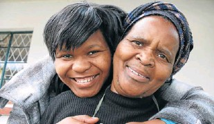 ?? Picture: DAVID MACGREGOR ?? ECSTATIC: Things may have been financially tough for 21-year-old Rhodes student Nozuko Ngqiyaza and her domestic worker mother Violet but this has not stopped her from scooping a top Rhodes University bursary in memory of the late community...