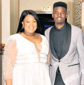 ??  ?? St Catherine's School Headgirl Olwethu Mbhele and her partner Njabulo Buthelezi. It is a tradition that the St Catherine's Headgirl has the honour of wearing white