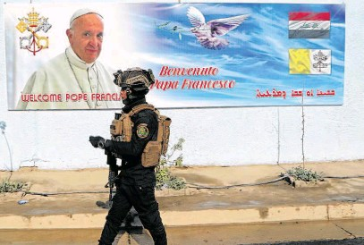 ?? PHOTOGRAPH: AP/PHOTO ?? ■ A member of the Iraqi armed forces guards outside St Joseph Chaldean Church in preparation for Pope Francis' trip to Baghdad, Iraq.
