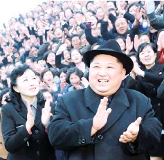 ?? — AFP photo ?? This file picture shows Kim (centre) is shown visiting the newly-renovated Pyongyang Teachers' University in Pyongyang.