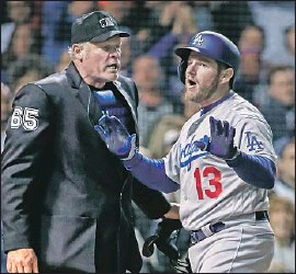 ?? Tannen Maury EPA / Shutterstock ?? MAX MUNCY is not pleased with a called third strike in the seventh inning by Ted Barrett, one of a few disagreements between the Dodgers and umpires.