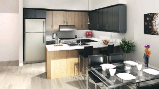 ??  ?? With Boro's two-storey townhouse designs, daytime living spaces like this kitchen/dining area are on a different level than more private nighttime spaces like bedrooms and bathrooms (below).
