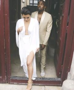 ?? KENZO TRIBOUILLARD / AFP / GETTY IMAGES FILES ?? Kim Kardashian and Kanye West leave their residence ahead of their 2014 wedding. Jamil Jivani says news of their possible divorce hit him hard.