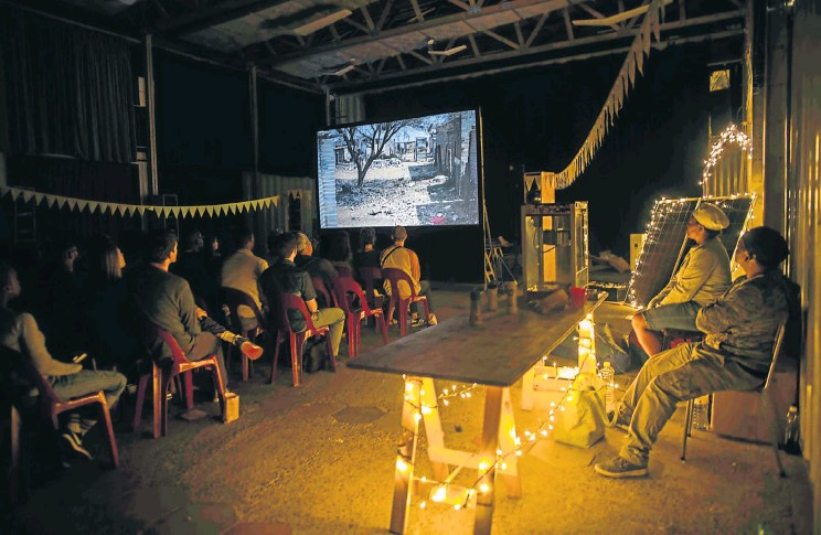 ?? Pictures: © Sydelle Willow Smith ?? POP-UP CINEMA An audience raptly watches the film 'This Land' in a Sunshine Cinema venue. The project brings socially significant films to rural and township communities bypassed by mainstream cinema.