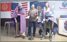 ?? HERALD photo/Amanda Duforat ?? Following the recent Veterans of Comedy fundraiser comedy show, two of the performers were presented with a Quilt of Valor. Michael Shields (right) and Chris Crawford (left) were presented with the quilts by Veteran Mike Tarpley (center).