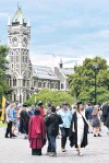 ?? PHOTO: PETER MCINTOSH ?? Big day . . . Graduands and their families make the most of graduation day near the University of Otago clock tower last December.