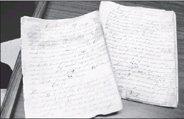 ?? Photo by Tara Bradbury/the Telegram ?? Journals belonging to Canon J. T. Richards, Anglican minister, educator and social advocate on the Northern Peninsula, who passed away in 1958. —