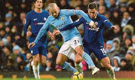 ?? AFP PIC ?? Chelsea's Eden Hazard (right) and Manchester City's David Silva tussle for the ball on Sunday.