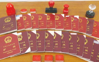 ??  ?? These Chinese passports and stamps were seized at properties owned by Xun Wang. Hundreds of his clients have been punished by border officials because they collaborated with the unlicensed immigration consultant.