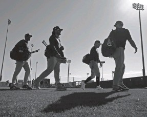 ?? JAE C. HONG/AP ?? The Cubs walk across the field during a workout Saturday in Arizona. Javy Baez, Kris Bryant and Anthony Rizzo can be free agents after the season.