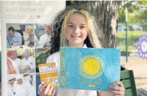 ??  ?? Flying the flag P7 pupil Murron Gibson was one of the winners