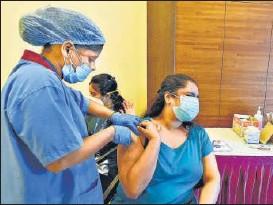 ?? VIJAY BATE/HT PHOTO ?? A beneficiary receives a dose of Covid-19 vaccine in Bandra, Mumbai on Sunday.