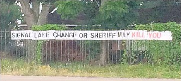 ?? Molly Hennessy-Fiske Los Angeles Times ?? A FEW DAYS after Sandra Bland's July 13 death in jail, the sign was put up near the spot where she was pulled over and arrested by a Texas state trooper. Prairie View residents don't know who posted the sign.