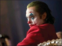 """?? Associated Press photos ?? This image released by Warner Bros. Pictures shows Joaquin Phoenix in a scene from """"Joker."""" On Monday, Phoenix was nominated for an Oscar for best actor for his role in the film."""