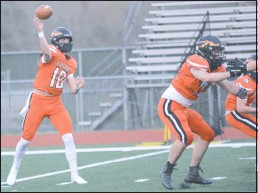 ?? PHOTO BY WILLIAM HAUFE ?? Easton senior quarterback Ryan O'Connor threw five touchdown passes in a game for the third time in his career Friday against Decatur.