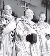 ?? PHOTO COURTESY SPECIAL COLLECTIONS/UNIVERSITY OF MEMPHIS LIBRARIES ?? Rev. Aaron T. Gildea (center), the pastor at St. Patrick's Catholic Church, marks 25 years in the priesthood in this photograph from June 17, 1954. Two Nashville pastors, Rev. Francis Eiseman (left) of Holy Rosary Church and Rev. Ed Dolan of St....
