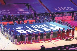 """?? MARTA LAVANDIER/ASSOCIATED PRESS ?? Members of the Miami Heat and Detroit Pistons hold a """"I Have a Dream"""" banner in honor of Martin Luther King Jr. during their game on Monday night in Miami."""